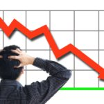 Man looking at downward graph